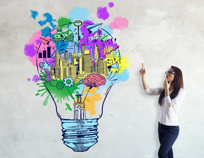 Creative business ideas. Attractive european on concrete background pointing at colorful lamp sketch. Creative business ideas stock photos
