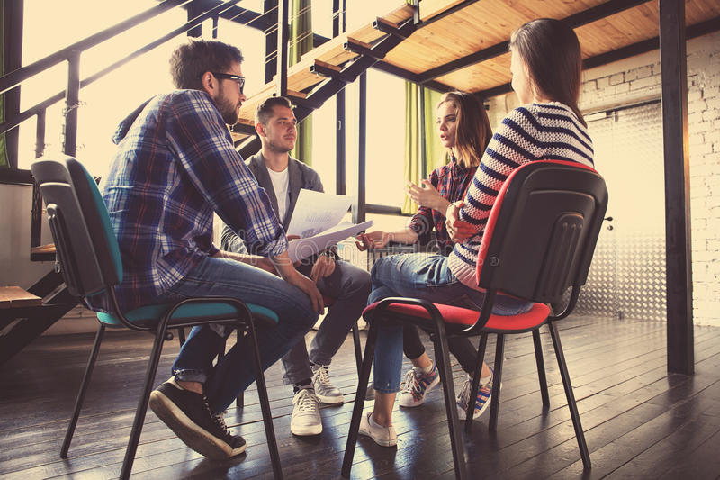 Creative business people meeting in circle of chairs. royalty free stock photo