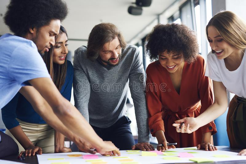 Creative business people planning with adhesive note. In the modern office royalty free stock photos