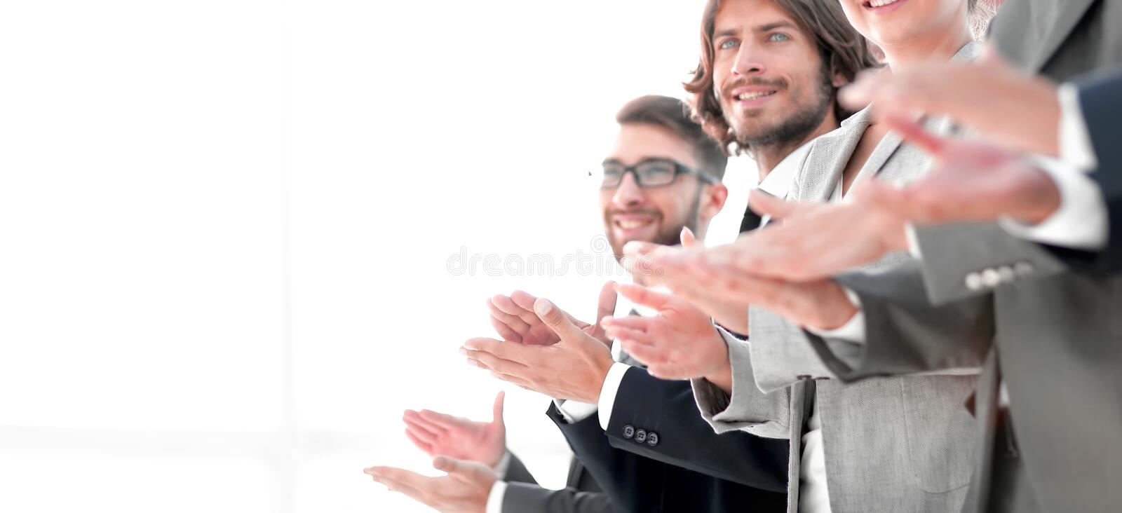 Creative business team applauding in officce. Creative business team applauding, standing in a row.photo with copy space royalty free stock images