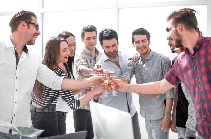 Creative business team celebrates their success. The concept of a startup stock photography