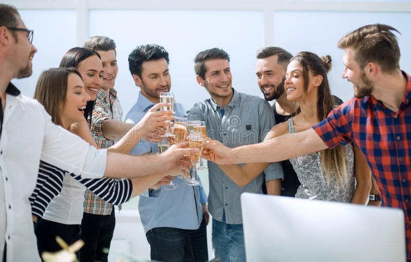 Creative business team celebrates their success. The concept of a startup royalty free stock photo