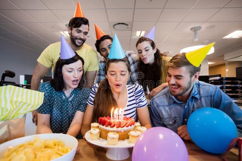 Creative business team celebrating colleagues birthday. In office stock image