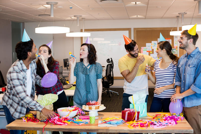 Creative business team celebrating colleagues birthday stock photo