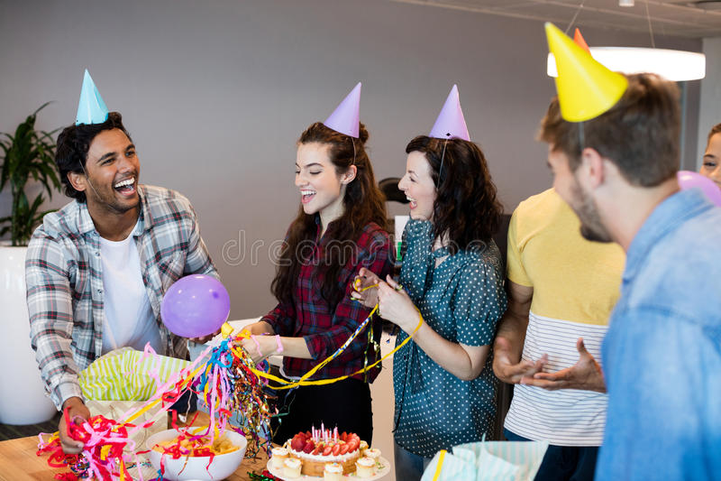 Creative business team celebrating colleagues birthday stock image