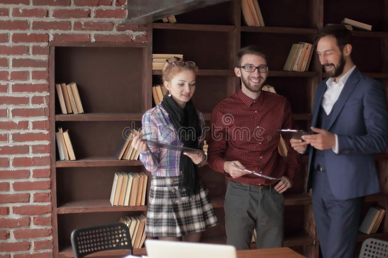 Creative business team discussing business documents in the Studio stock image