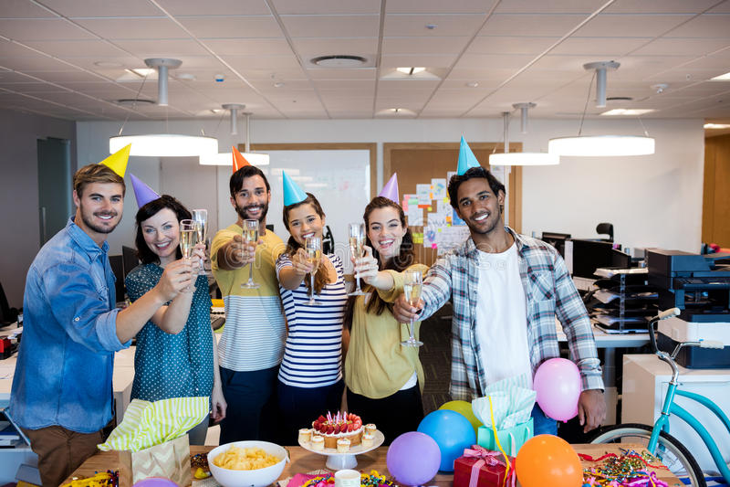 Creative business team having a toast on colleges birthday stock photos