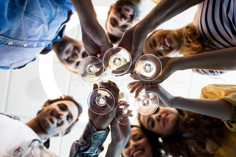 Creative business team having a toast on colleges birthday at office. Close-up of creative business team having a toast on colleges birthday at office royalty free stock photography