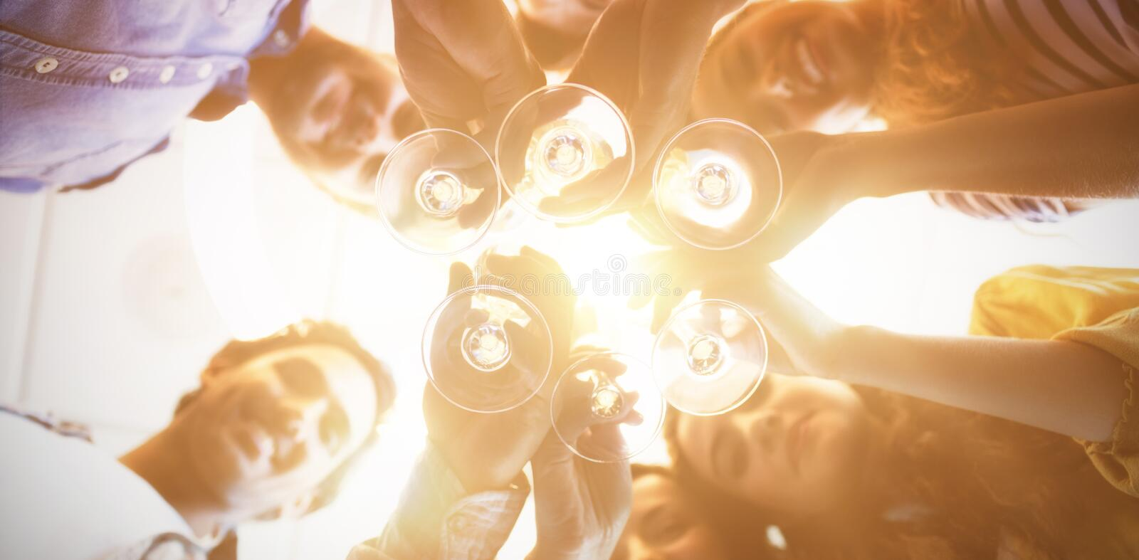 Creative business team having a toast on colleges birthday at office royalty free stock photo