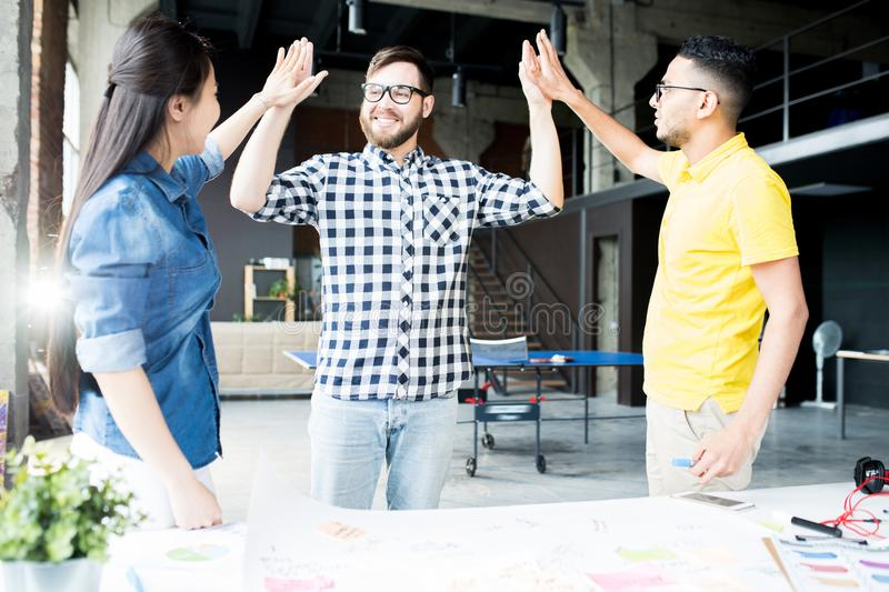 Creative Business Team High Five in Office stock image