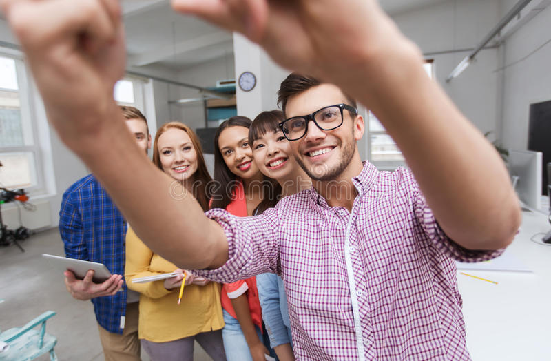 Creative business team taking selfie at office stock photo