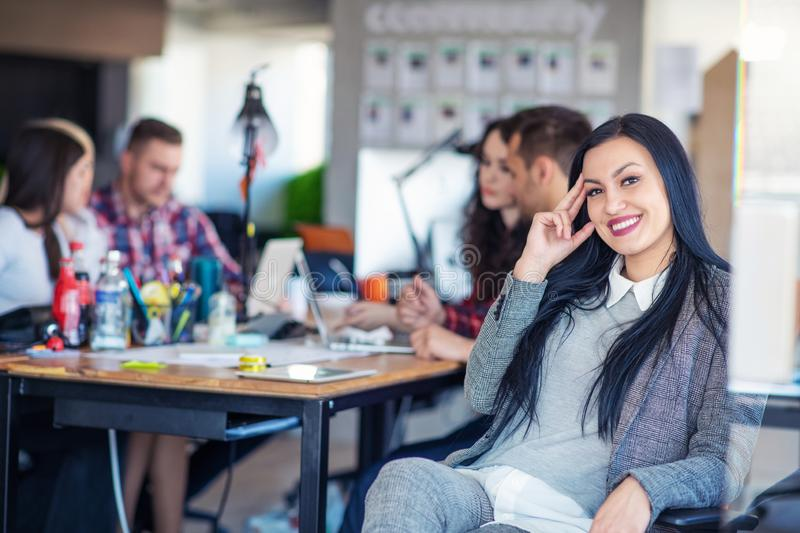 Creative business team working hard together in casual office royalty free stock images