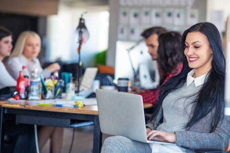 Creative business team working hard together in casual office stock images