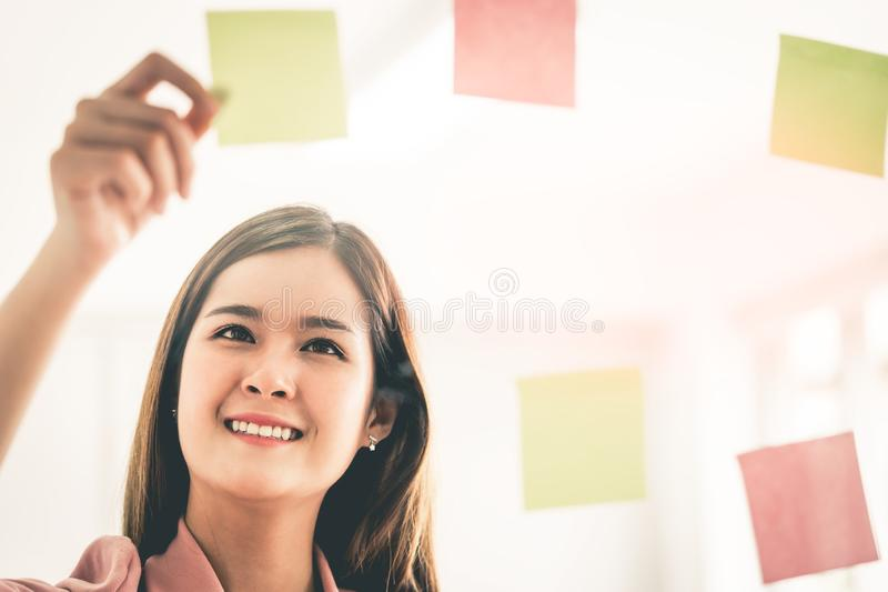 creative business woman is writing ideal and goal on to t royalty free stock images