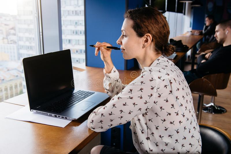 Blogger working out of office, business woman royalty free stock photo