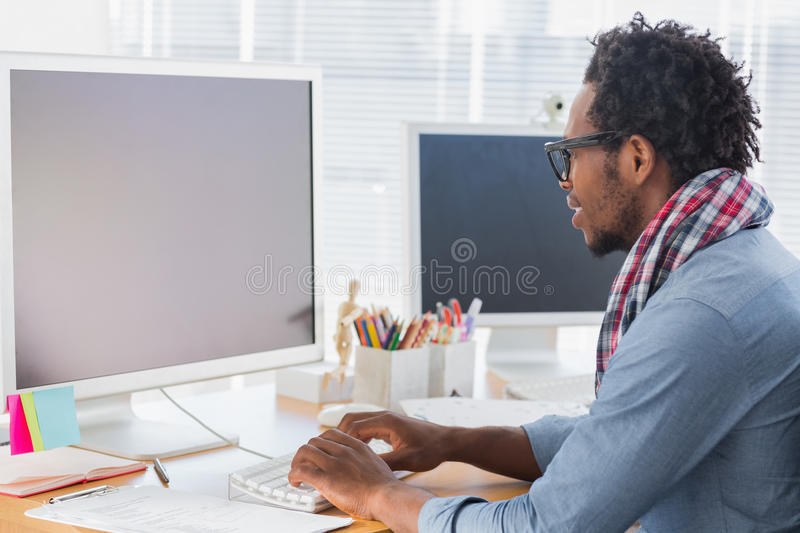 Creative business worker on computer stock images
