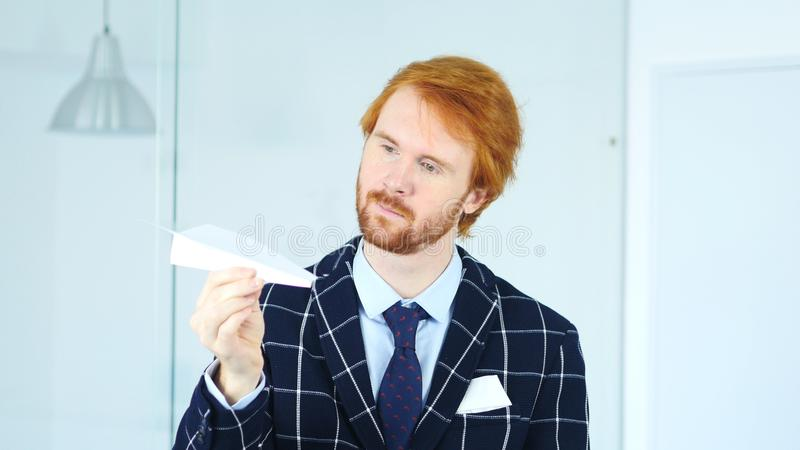 Creative Businessman Holding Paper Plane in Hand, Time to Fly royalty free stock photography