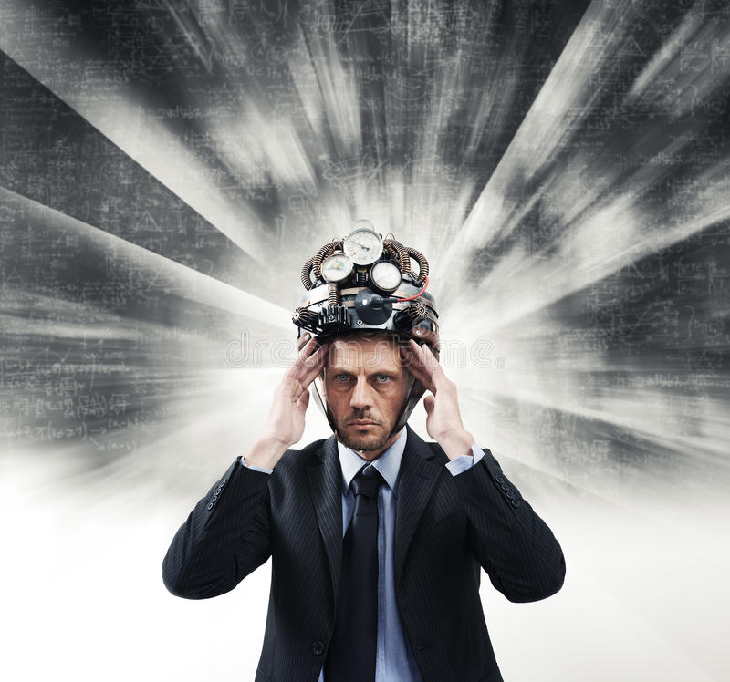 Creative businessman with steampunk helmet. Confident businessman thinking with head in hands wearing steampunk helmet stock photography