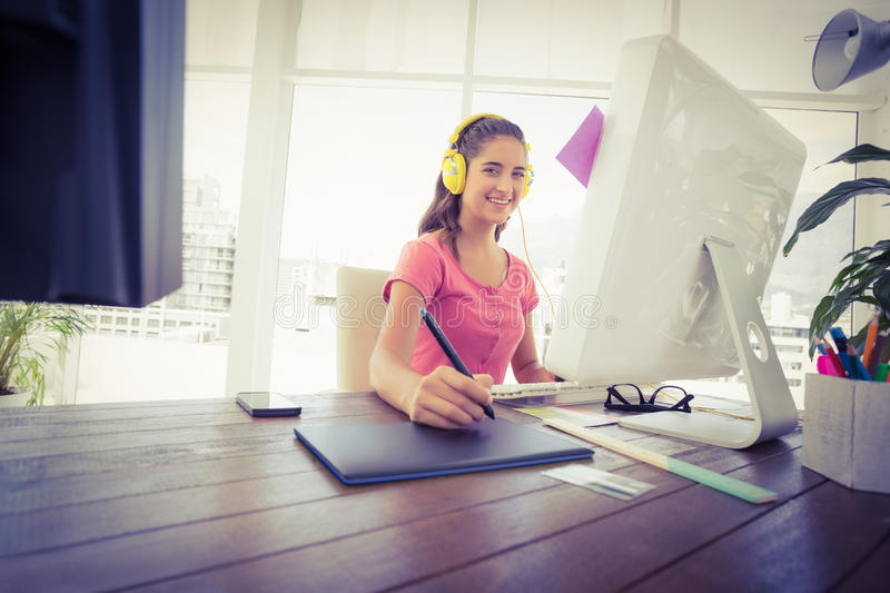 Creative businesswoman writing on a tablet. In the office stock photo