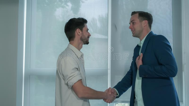 Creative casual business meeting of two young men. stock images