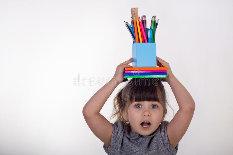 Creative child over white background. Office supply objects collection. stock images