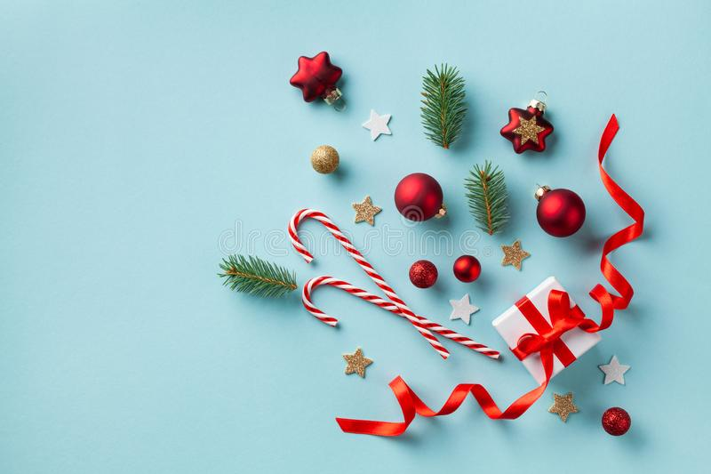 Creative Christmas composition made of gift box and holiday decorations on blue background top view. New Year card. Flat lay. Creative Christmas composition made royalty free stock photos