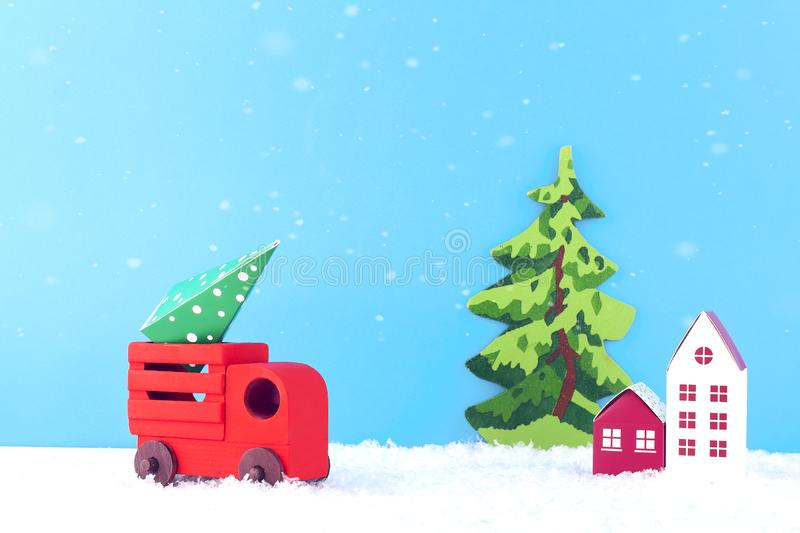 Creative christmas composition. Red car carries a Christmas tree. Paper art of Merry Christmas and New Year. royalty free stock image