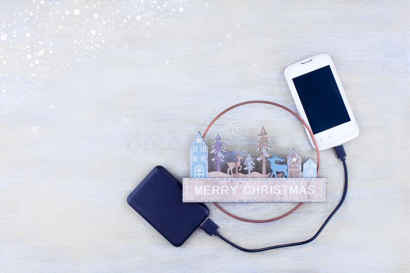 Creative christmas composition with smartphone and power bank. royalty free stock photos
