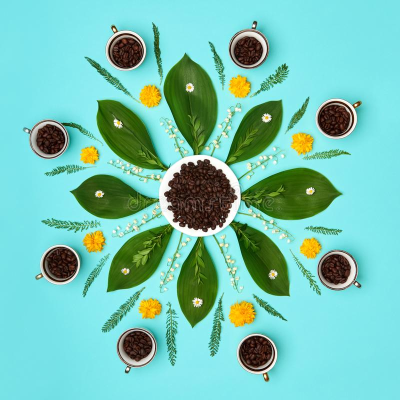 Creative coffee beans with flowers mandala pastel coloured art background. Good Morning Coffee floral setup. stock photo