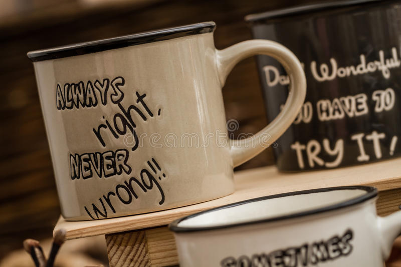 Download Creative, Coffee Mugs With Text On A Background Created By Leave Stock Photo - Image: 83710924