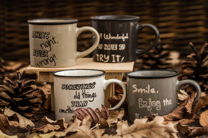 Download Creative, Coffee Mugs With Text On A Background Created By Leave Stock Photo - Image: 83712580