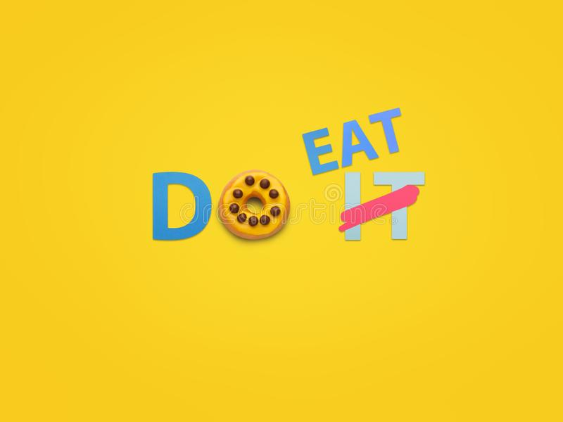 Creative composition of letters and doughnut stock photos