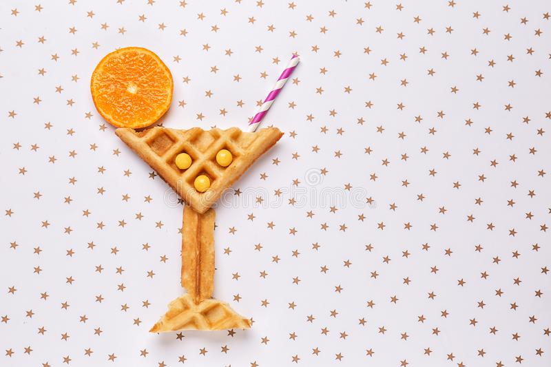 Creative composition with waffles on light background stock photos