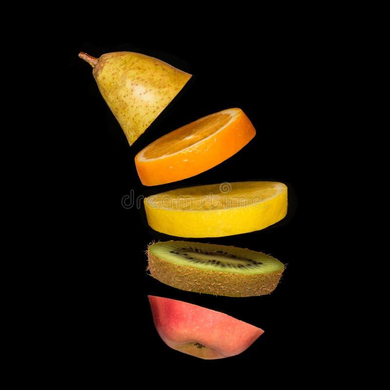 Creative concept with flying fruit. Pear, orange, lemon, kiwi, apple royalty free stock image