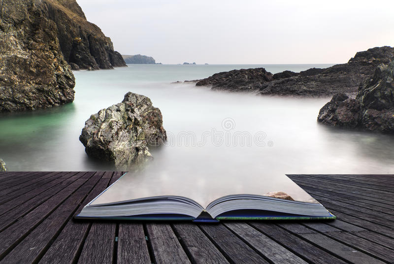 Creative concept pages of book Long exposure Kynance Cove tide stock photography