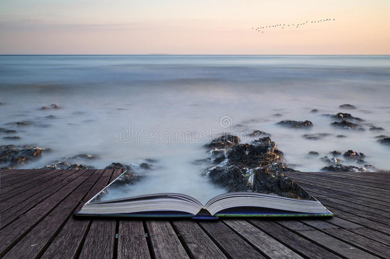 Creative concept pages of book Long exposure landscape rocky shoreline at sunset. Creative concept pages of book Landscape image of rocky beach at susnet with royalty free stock photo