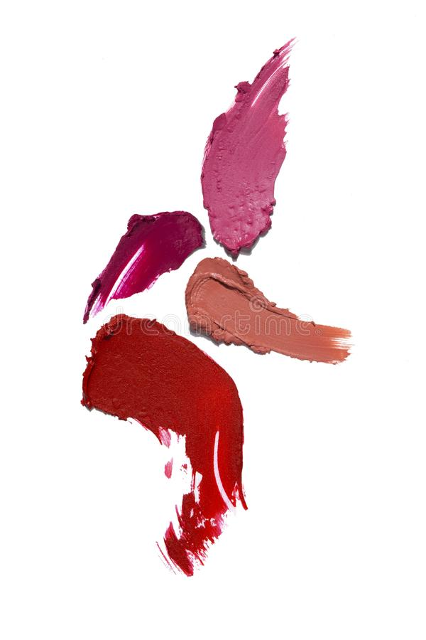 Beauty swatches. Creative concept photo of cosmetics swatches beauty products lipstick on white background royalty free stock image