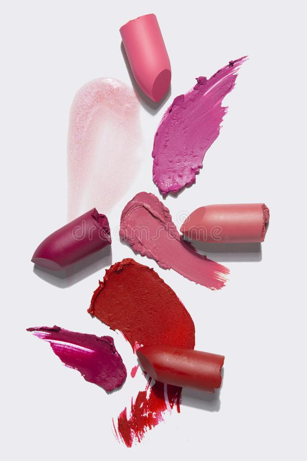Beauty swatches. Creative concept photo of cosmetics swatches beauty products lipstick on white background royalty free stock images