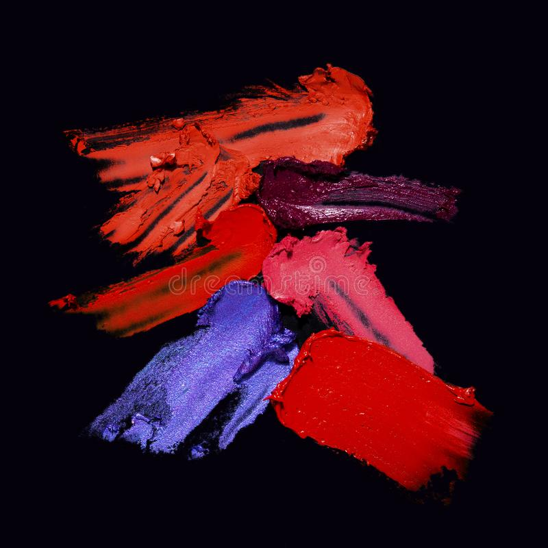 Beauty swatches. Creative concept photo of cosmetics swatches on black background royalty free stock photography