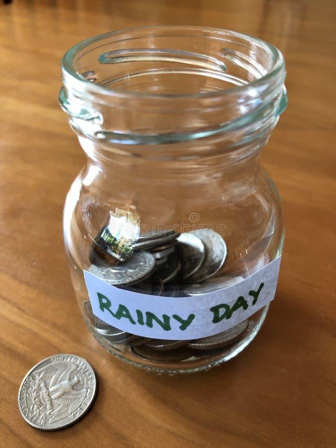 Creative concept, Saving for a rainy day royalty free stock photo