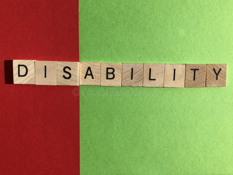 Creative Concept : the word Disability in wooden letters stock photography