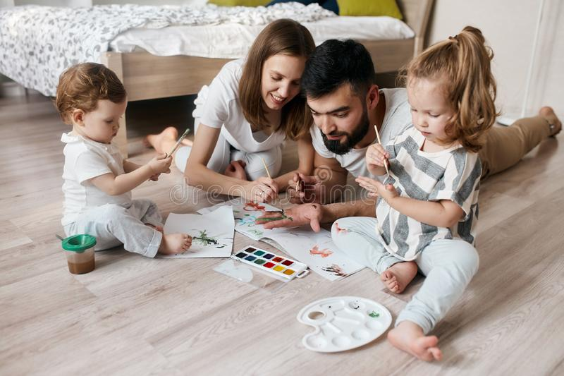 Creative couple and their children preparing a gift for their grandparents stock image