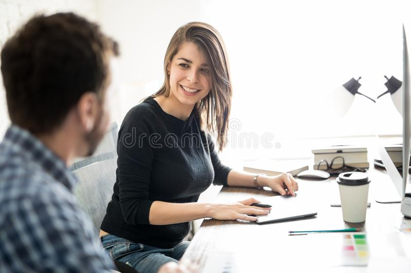 Creative coworkers working together royalty free stock photos