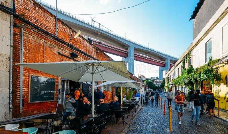 Creative and cultural area in Lisbon called LX factory where tourists enjoy of restaurants, galleries and music stock photo