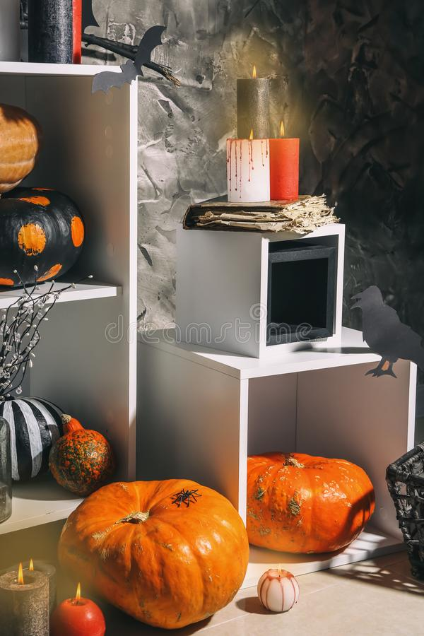 Creative decorations for Halloween party on light floor indoors stock photos