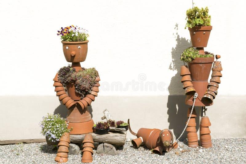 Flower pots creative designed - man, woman, dog stock images