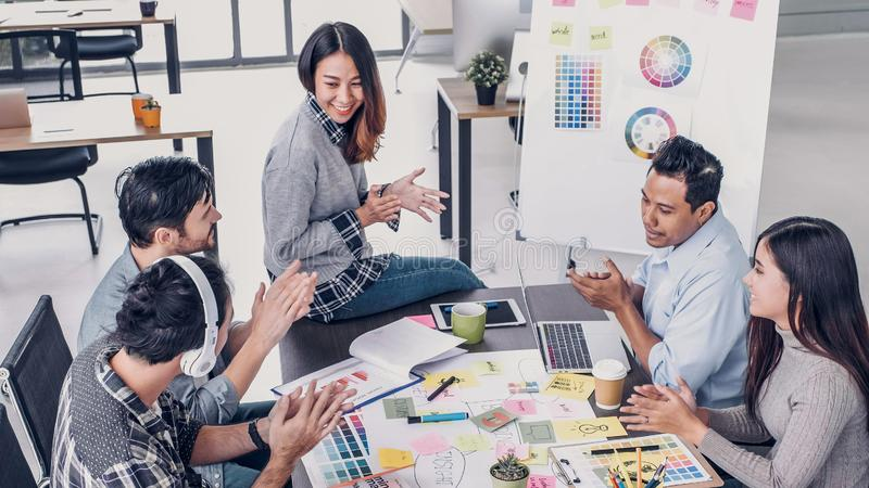 Creative designer applaud for job success at meeting table at office.  royalty free stock photos