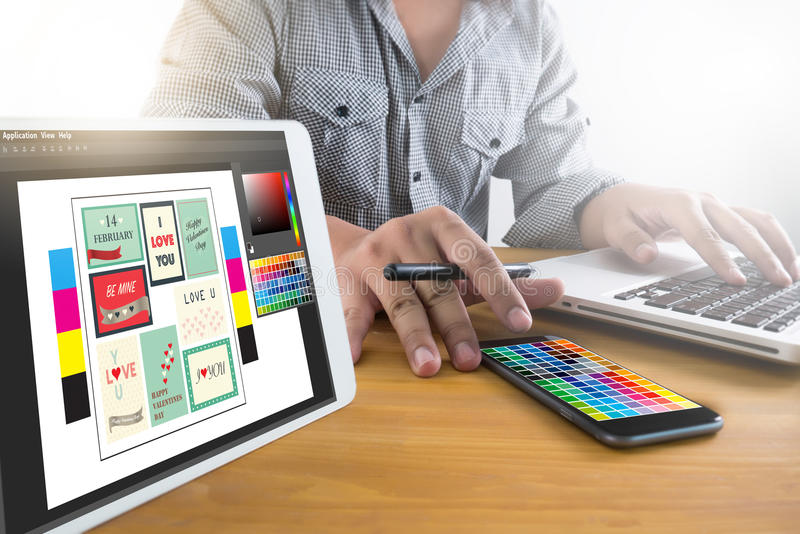 Creative Designer Graphic at work. Color swatch samples, Illustrator Graphic designer working digital tablet and computer royalty free stock photography