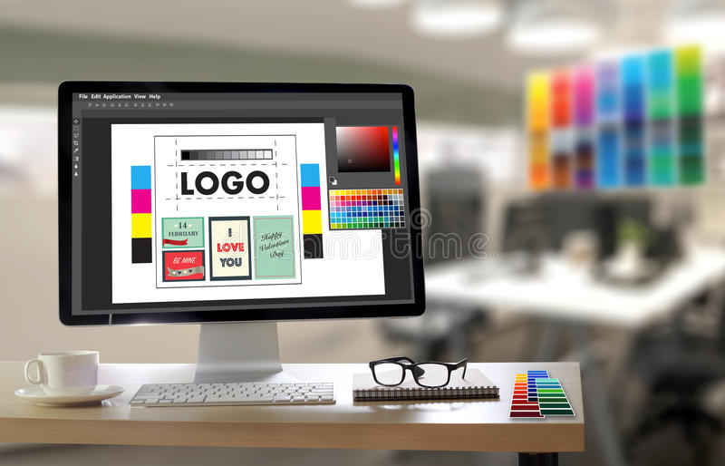 Creative Designer Graphic at work. Color swatch samples, Illustrator Graphic designer working digital tablet and computer royalty free stock photo