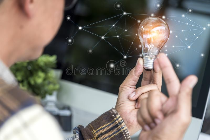 Creative designer holding light bulb stock image